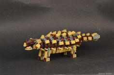 "https://flic.kr/p/TdxQmu | Ankylosaurus | ""Ankylosaurus is a genus of armored dinosaur.  Fossils of Ankylosaurus have been found in geological formations dating to the very end of the Cretaceous Period, between about 68–66 million years ago, in western North America, making it among the last of the non-avian dinosaurs. The genus name means ""fused lizard"" and the specific name means ""great belly"". Though other members of Ankylosauria are represented by more extensive ..."