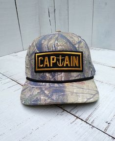 bea4087942e Captain Fin Camouflage Snapback Hat Surfing Hunting Fishing  fashion   clothing  shoes  accessories