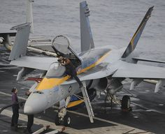 "GULF OF OMAN (June 15, 2013)) – Plane captains run checks on an F/A-18C Hornet assigned to the ""Blue Diamonds"" of Strike Fighter Squadron (VFA) 146 on the flight deck of the aircraft carrier USS Nimitz (CVN 68). Nimitz Strike Group is deployed to the U.S. 5th Fleet area of responsibility conducting maritime security operations, theater security cooperation efforts and support missions for Operation Enduring Freedom. (U.S. Navy Photo by Chris Bartlett/Released)"