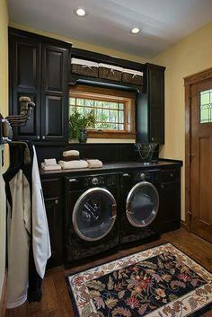 Love this laundry room ... and check out the clothes hooks on the left wall!