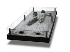 I can't believe this actually exists...Han Solo in carbonite coffee table.  SERIOUSLY!