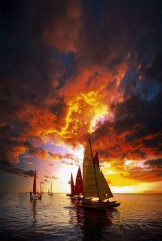 Sunset sailing under the fire clouds.