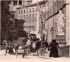 Foto dal Ponte Santa Trinità verso la piazza omonima,via Tornabuoni il tutto sovrastato dalla Colonna della Giustizia