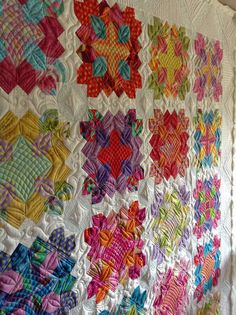 Patchwork of the Crosses quilt, stunning in bright colors. From Postcards from Panama.
