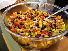 My recipe for Cowboy Caviar...do not follow the link.Serve with Tostitos Scoops  1 can each:  black beans  black eyed peas  chick peas  yellow corn  white shoe peg corn   1 can sliced black olives  2 small cans chopped green chilies 1-2  cans of diced   1 can of Rotel  1 jalapeno or more   1 medium  sweet onion  1 medium  red onion   green onions   1 lg green pepper  1 lg red pepper  2-3 bottles of fat free Italian dressing. Has to be fat free.