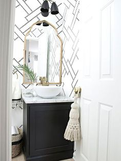 black and white stenciled powder room with black cabinet, white vessel sink, marble counter and gold accents The new gold arched mirror is here Source by jakonya The post The new gold arched mirror is here appeared first on Susannah Kenny Interiors. Bathroom Makeover, Powder Room Design, Gold Bathroom, Black Cabinets, Downstairs Bathroom, Bathrooms Remodel, Bathroom Design, Bathroom Decor, Arch Mirror