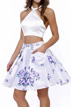 If you want style, this is your dress! Floral print is the new trendy style! Get this gorgeous two piece dress now! It features a unique halter top, a two piece design, and yes it has pockets! Compare