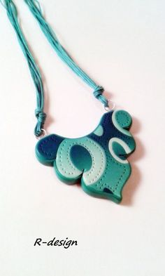 Azur and beautiful turquoise polymer clay gradient. Special color created a special form. Shows a wonderfully elegant necklace everyday wear