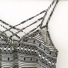 Jack by BB Dakota Esmay Tribal Tank Asymmetrical tank top with tribal print and criss-cross straps in the back. Only worn a couple of times and in perfect condition! BB Dakota Tops Tank Tops