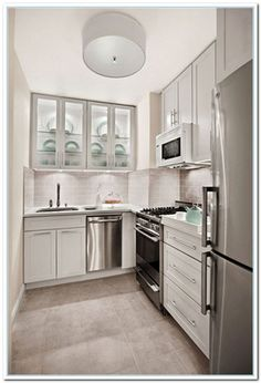 L Shaped Kitchen With Flush Mounted Lighting Remodeling Small L Shaped Kitchen Check more at http://www.wearefound.com/remodeling-small-l-shaped-kitchen/