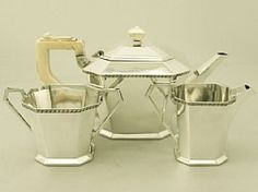 A fine antique George V English sterling silver and ivory handled three piece tea service in the Art Deco style; part of our silver teaware collection http://www.acsilver.co.uk/shop/pc/Sterling-Silver-Ivory-Handled-Three-Piece-Tea-Service-Art-Deco-Style-Antique-George-V-96p3073.htm