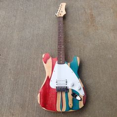 Recycled Skateboard Guitar by SkateboardEverything on Etsy