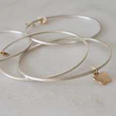A custom gold flower detail on our dancers bangle 🌼 We believe your jewellery should be a way to tell your own story. Please feel free to get in touch with any personalisation ideas you may have. Custom Jewelry Design, Custom Design, Silver Bangles, Gold Flowers, Dancers, Recycling, Charmed, Touch, Jewellery