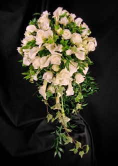 White calla lily, rose with freesia and ivy cascading bridal bouquet. Stunning!
