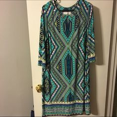 Chicos Print Dress Size 2 (12/14) Super cute Chicos dress. Bought and took the tags off to try on but never wore it. NWOT. Sleeves are 3/4 as pictured. Price firm Chico's Dresses Midi
