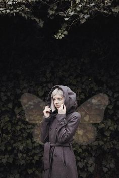Aurora Aksnes, this coat is very cute especially with the hood, and the waist being able to accentuated.