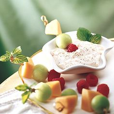 Summer appetizers - fruit syrup with yogurt, whipped cream, honey or marshmallow