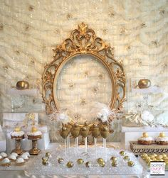 Elegant gold and white wedding dessert table display - love the gold frame at the back