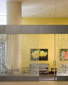 Yellow walls and frosted decals on glass for low privacy with decorative effect