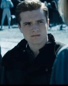 So cute, he looks so mad at the peacekeeper for whipping Katniss