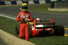 Ayrton Senna of Brazil walks away from his car during the Spanish Grand Prix at the Jerez circuit in Spain. Senna retired from the race with a punctured radiator. Formula 1, Sport Cars, Race Cars, San Marino Grand Prix, Spanish Grand Prix, 4 Wheelers, Mclaren Mp4, F1 Drivers, Auto Service