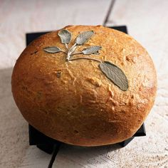 This recipe makes tender, savory bread flavored with sage, whole wheat flour, and a bit of cornmeal. Add fresh sage sprigs before baking for an artful garnish.