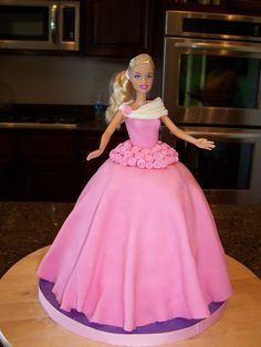 """Madison's Barbie Cake - I made this cake for my daughter's 6th birthday.  It was a chocolate cake (9"""" round and Pampered Chef Large Batter Bowl) with fondant dress and roses."""