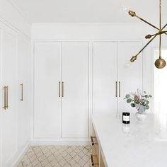 White Bi Fold Closet Doors with Long Brass Pulls