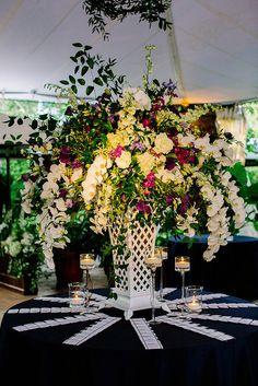 Cascading white & purple centerpiece #weddings #centerpieces #blisschicago