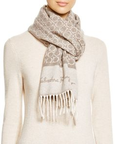"""Gancini logo print signifies classic Italian style on this rich cashmere scarf by Salvatore Ferragamo. 