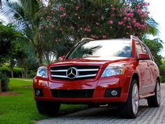 ~ The 2010 Mercedes-Benz GLK 350 in Mars Red.  This is the ONLY color in their entire fleet of SUVs that I absolutely love.  Esp. since red is my very favorite color.  Now, where are my car keys? ~