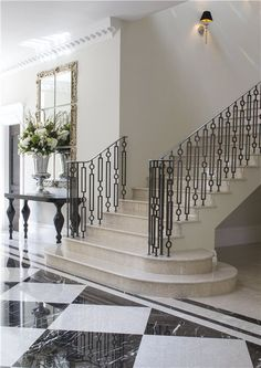 Black and White Tiles with Black Iron Railing.