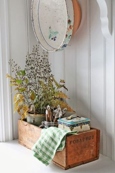 Vintage wooden catch-all with vintage tins... Lovely display!