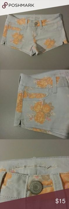 """American Eagle Shorts floral-print size 2 American Eagle floral print shorts.  Women's size 2.  Pale blue with peach colored flowers.  Shorts measure 10.25"""" long.  Very short style.  Low-rise. Clean and worn a few times.  From a smoke-free and pet-free environment American Eagle Outfitters Shorts Jean Shorts"""