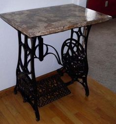 My husband made this table from an old sewing machine stand his father gave him. He made the top himself. No, that is not granite or marble, that is concrete. Next house project, do that to all the counter tops in the kitchen.
