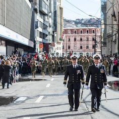 Two members of the Chilean navy lead the procession of the armed forces on Día de las Glorias de la Armada (Navy Day) in Valparaiso Chile.