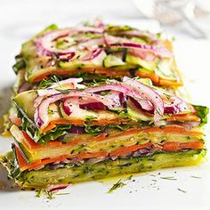 Stacked Summer Vegetable Salad | Elegant Foods and Desserts||  3medium yellow or green zucchini Kosher salt 4medium carrots ½small red onion 1 to 2cups torn leaf lettuce 3tablespoons lemon juice ¼cup olive oil or canola oil 2tablespoons snipped fresh dill Freshly ground black pepper