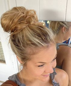 "Longtime fan of the ""messy bun"" - up high or at the nape.  2nd, 3rd day shamp'd (dirtier) hair is usually best.  The more natural/untamed/un-smoothed it is, the better the ""mess"".  Great when dressing down or up. Here's one way to do it:  Messy Bun Tutorial"