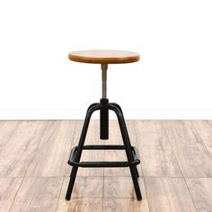 Industrial Modern Adjustable Stool - This industrial modern stool is featured in a durable metal with a glossy black finish. This stool has a round solid wood seat, slanted legs and an adjustable height base. Perfect for a desk workstation! Loveseat is the best way to buy vintage home furniture in San Diego & Los Angeles.  Shabby Chic, Vintage, Mid Century Modern and much more.