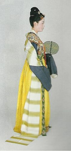 """Scan P3: Court lady of the Nara Period (710-784) , Japan. Textiles during this period of Japan were often brocade ones heavily influenced by China (and in some cases the cloth itself was directly imported from that country) . Scan from book """"The History of Women's Costume in Japan."""" Scanned by Lumikettu of Flickr. Japanese costume many centuries ago…recreation accomplished in Kyoto during the 1930's.."""