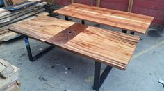 Book-matched redwood slabs and monkey-pod joined with a black walnut stripe.