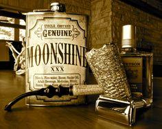 "Gillette Aristocrat, 1946-47 vintage, with Missouri Meerschaum ""Freehand"" pipe, Stetson aftershave, ""Genuine Moonshine"" flask"