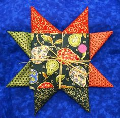 Fat Quarter Star -- Five coordinating fat quarters packaged in a cute star-shaped bundle tied together with a raffia bow!  These fat quarters are metallics from Blank Quilting.  Great for Christmas projects!