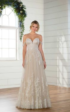 Brides in search of the perfect shimmering gown for their wedding day, look no further than this off-the-shoulder wedding dress with sparkle from Essense of Australia. Drapey, lace off-the-shoulder straps perfectly accentuate the sweetheart neckline of this gown.