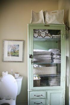 vintage cabinet as bathroom storage.