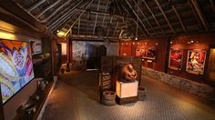 The interior of the Museum of Popular Arts at the Discover Mexico Cultural Park in Cozumel reveals a collection of Mexican pottery, baskets and paintings