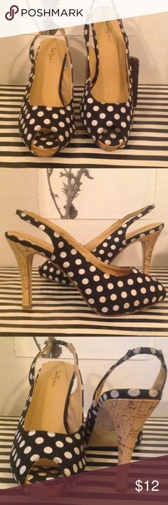 """F21 FABRIC POLKA DOT SLING BACKS Soooo cute! The perfect pair of shoes for anything ROCKABILLY or the current flounce midi skirts & dresses trend. They originally had a size sticker of the bottom of the shoe but while wearing, it went MIA. They are a canvas fabrication w/ a black background & """" not so stark"""" white polka dots. The heels are covered in a thin cork overlay & the height is 4"""" w/ a 1/2"""" front platform. They are clean, sanitized & free of any stains, damages or other blemishes ;-)…"""