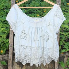 Light grey vintage top by megbydesign on Etsy. Made from a vintage tablecloth. $145.