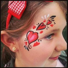 Hearts face paint eye design teenager