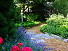 Stone and Gravel Combo A traditional gravel path gets an update thanks to decorative stone chips and staggered Eden dimension stones that provide a landing spot and engage the eye. Stone edging keeps the gravel in line.
